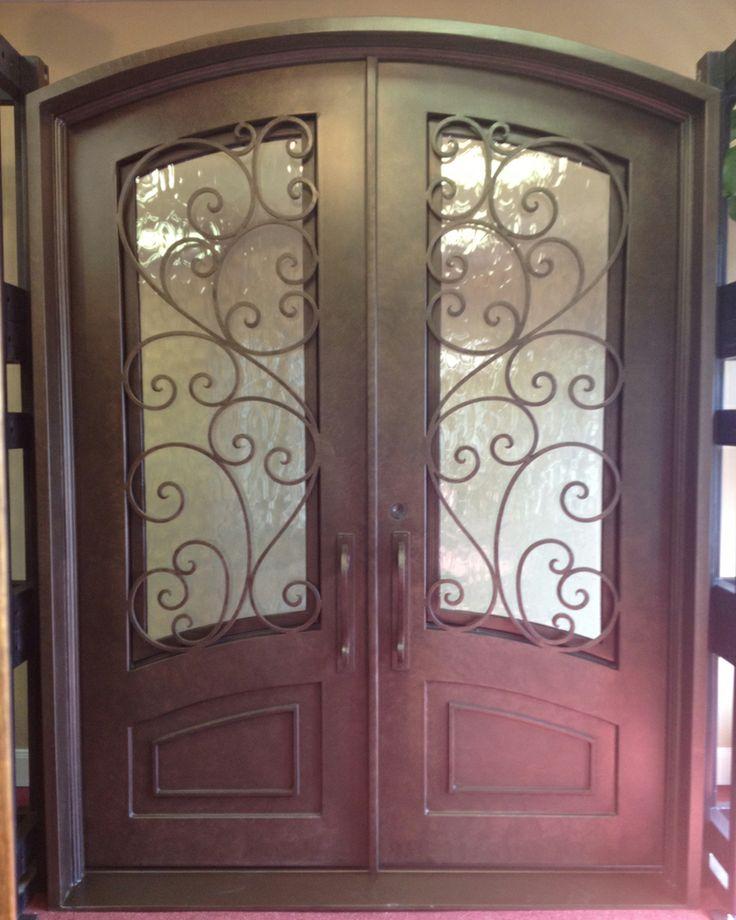 Granada arch double door the front door company for Wood doors with wrought iron