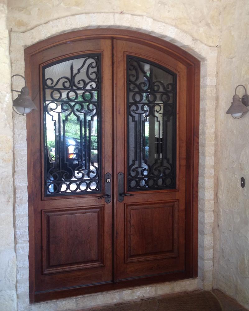 Wood and iron door gallery the front door company for Rustic exterior doors