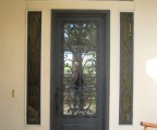 IDG1912-Milan_Iron_Door_with_Raised_Panel_and_Custom_Sidelite_and_Transom_Grills